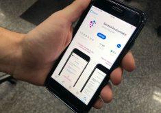 Celular na mão em referência a Aplicativo da Serasa ajuda consumidores a quitar suas dívidas