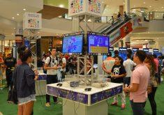 Pessoas jogando videogame em referência a Museu do videogame itinerante chega a Fortaleza com exposições e ilhas de consoles