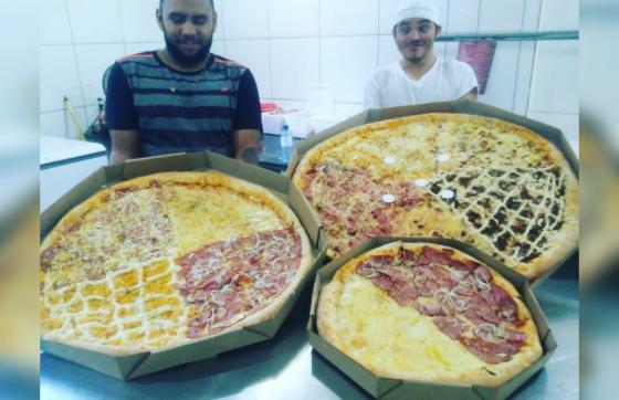 As pizzas de 90, 70, e 47 centímetros de diâmetro são comparadas (FOTO: Reprodução/WhatsApp)